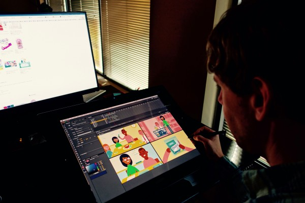 Trevor reviews some artwork and makes sure the color palette is working.